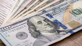 К закрытию межбанка доллар подешевел на 14 копеек